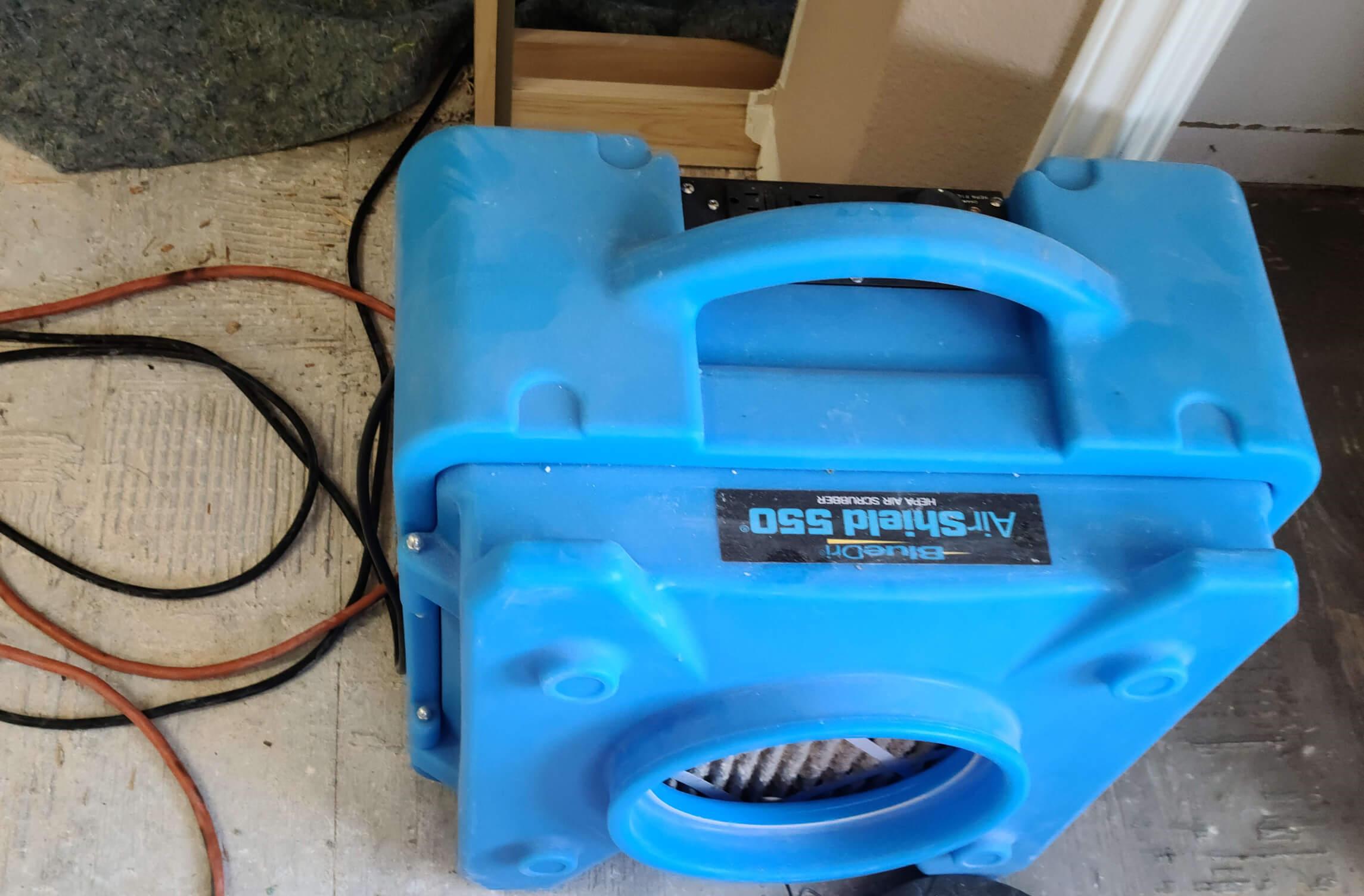 A blue air scrubber