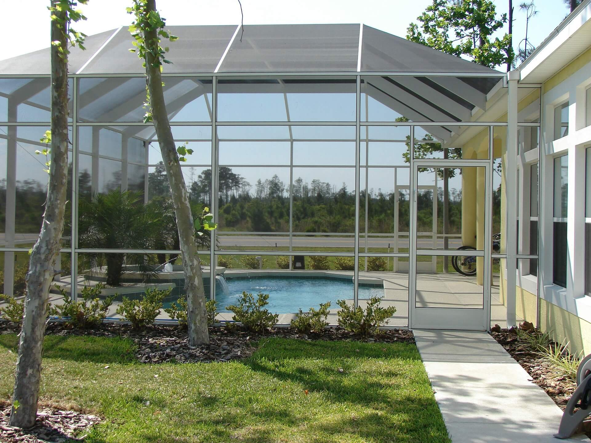 Luxurious pool with a full glass building surrounding it
